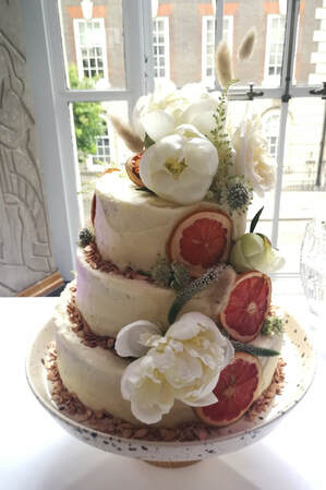 Three tier Polly wedding cake with peonies