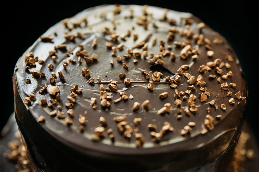 Close up of Stevie chocolate cake with bronze cocoa nibs